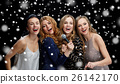 happy young women with microphone singing karaoke 26142170