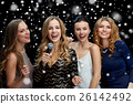 happy young women with microphone singing karaoke 26142492