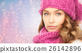 close up of woman in hat and scarf over lights 26142896