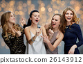 happy young women with microphone singing karaoke 26143912
