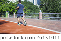Man running in the running way in the garden park. 26151011