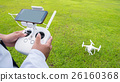 Hand holding on remote for Control drone. 26160368