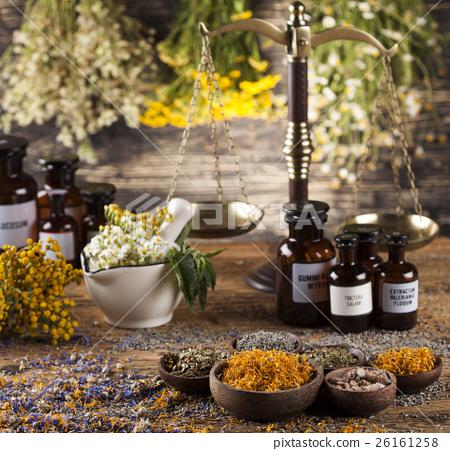 Herbal medicine on wooden desk background 26161258
