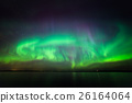 Northern lights over lake in finland 26164064