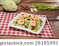 Plate of fried shrimp with vegetables on the tabl 26165091