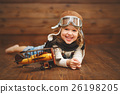 funny child girl pilot aviator with airplane laughing 26198205