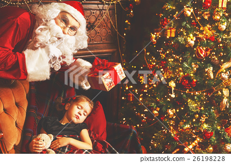 Santa Claus presents Christmas gift to sleeping child girl in Ch 26198228
