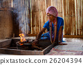 Old female karen hill tribe is cooking traditional 26204394