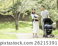 Babies and parents taking a walk in the park 26215391