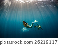 Mermaid swimming underwater in the deep blue sea 26219117