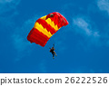 Skydiver and colorful parachute on blue sky  26222526