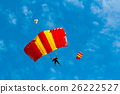 Skydiver and colorful parachute on blue sky  26222527