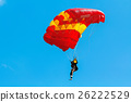 Skydiver and colorful parachute on blue sky  26222529