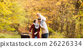 Beautiful young family on a walk in autumn forest. 26226334