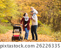 Beautiful young family on a walk in autumn forest. 26226335