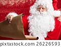 Portrait of happy Santa Claus holding Christmas 26226593