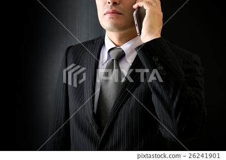 A man who makes a phone call 26241901