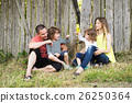 Beautiful young family against old wooden fence 26250364