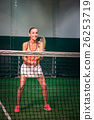 Cheerful smiling woman playing tennis 26253719