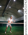 Handsome professional man playing tennis 26253742