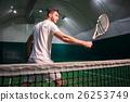 Pleasant professional sportsman playing tennis 26253749