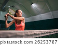 Pleasant involved woman playing tennis 26253787