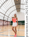 Cheerful slim sportswoman standing in indoor 26253795