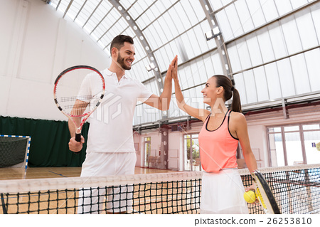 Positive tennis players giving high five 26253810