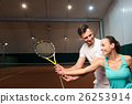 Positive instructor teaching to play tennis 26253914
