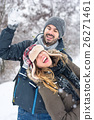 Couple having fun in snow covered park 26271461