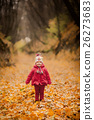 Little girl in red coat at scenic fall park 26273683