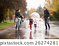 Family with daughters under the umbrellas, running 26274281