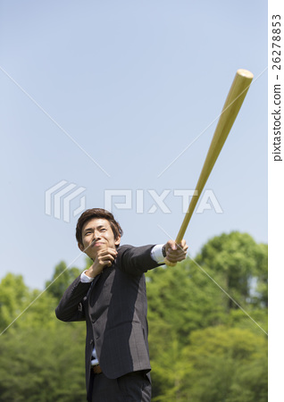 A businessman with a baseball bat 26278853