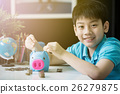 Little asian boy insert coin into piggy bank 26279875