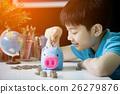 Little asian boy insert coin into piggy bank 26279876