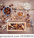 Different kinds of nuts . 26308030