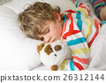 little blond kid boy in colorful nightwear clothes 26312144