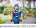 Happy kid boy having fun with snow on way to 26312183