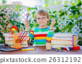 little school kid boy with glasses holding wax 26312192