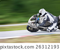 Motorcycle leaning into a fast corner on track 26312193