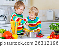 Two little kid boys cooking pasta with vegetables 26312196