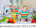 Two little kid boys cooking pasta with vegetables 26312198