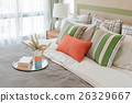 colorful pillows on white bed in modern bedroom  26329667