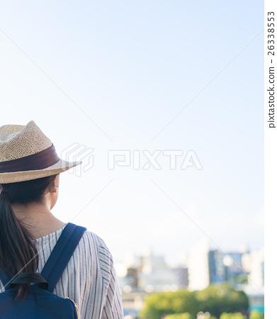 A woman walking 26338553