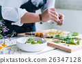 Chef cooks meal 26347128