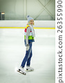 Beautiful girl in winter clothes and skates on ice 26355990