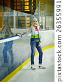 Beautiful girl in winter clothes and skates on ice 26355991