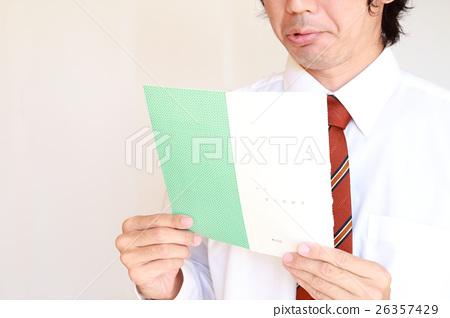 A businessman looking at the bonus statement 26357429