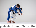 The two judokas fighters fighting men 26366369