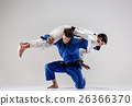 The two judokas fighters fighting men 26366370